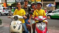 Ho Chi Minh City Night Tour by Motorbike Including Saigon Street Food