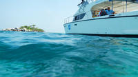 VIP Dinner and Dolphins Power Catamaran Sail to Racha and Mai Ton Islands from Phuket