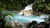Blue Volcanic River Waterfalls and Hot Springs Mud Bath Adventure in Rincon de la Vieja from La Cruz