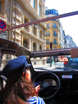 "Being in (typically) slow traffic gives us a chance to admire the relatively ""modern"" 19th century Haussmanian buildings found throughout much of Paris, Barrie S - September 2011"