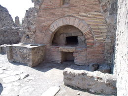 Pompeii tour. A 2000 year old oven. Pompeii had it already figured out. Pizza oven? , Papa Harold - July 2013