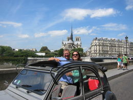 Our guide/driver kindly got out and took a photo of us in the 2CV with Notre Dame in the background., Barrie S - September 2011