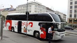 Tour bus and driver waiting for pickup at Opera House in Vienna. , Edward K - August 2014