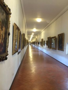 Long walk on the Vasari Corridor above the buildings on the Ponte Vecchio. It was a bit surreal to imagine the Medici family walking these same halls. , Lisa C - July 2014