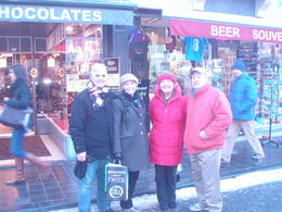 In front of candy store in Brugge with another couple we met on tour , Barry B - January 2013