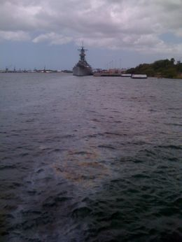 Standing on the Arizona Memorial, there is still oil rising from the sunken battleship. You can see the oil drifting in the current toward the Missouri. , Donald H - June 2011