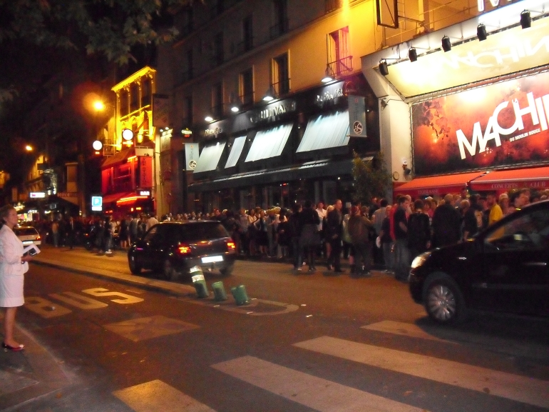 Queues outside to get into the Moulin Rouge - Paris