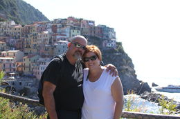 My wife and I in front of one of the beautiful towns of Cinque Terre , Frank B - October 2014