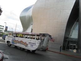Photo of   Seattle Duck passing by Experience Music Project building