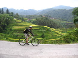 Just riding along with the rice terraces in the background - May 2012