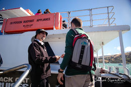 Photo of Christchurch Akaroa Harbour Nature Cruise Our excellent and friendly Skipper - Julian taking tickets