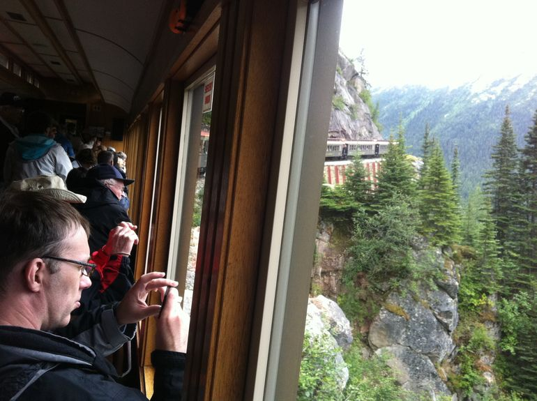 People taking pictures on the Skagway Railway - Skagway