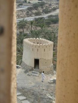 Looking through the slots in the top of the larger fort towards the smaller fort overlooking the Al Bidya mosque, Fujairh Emirate., Frederick C - January 2008