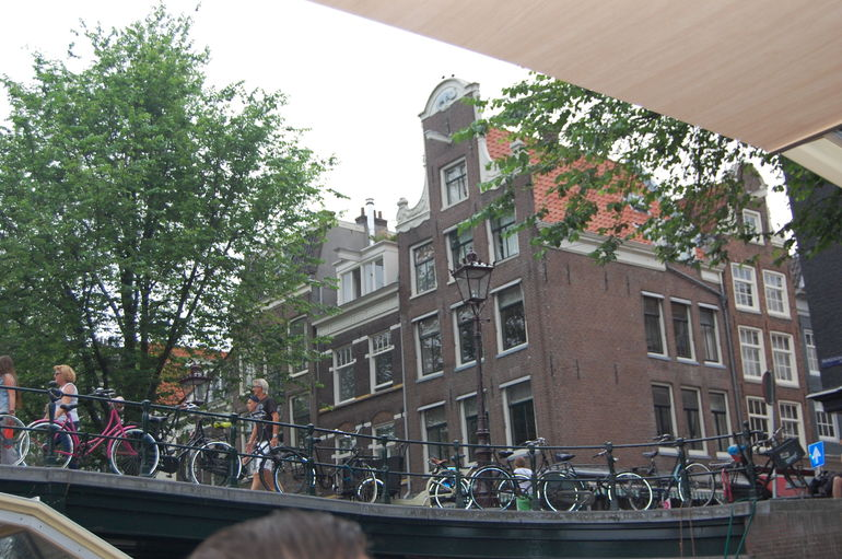 View of Amsterdam from hop on hop off canal boat - Amsterdam