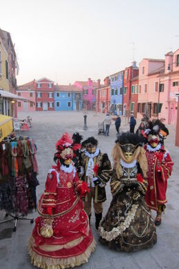 While exploring the island of Burano, we encountered a group of people dressed elaborately for Venice's famous Carnivale. They loved the attention and stopped for us to take a few photos of them. , Kristine D - March 2012