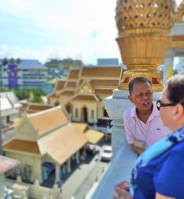 Tour guide explaining the purpose of the buildings surrounding the golden temple. , MAYBELLE S - May 2015