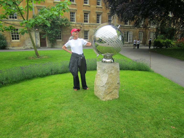 Linda admiring the globe that commemorates the first class of females at Balliol College, Oxford (early 1970's).
