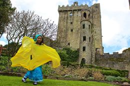 Our daughter borrowing her mom's yellow cover at Blarney Castle , JumpingNorman - May 2014
