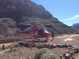 Photo of Las Vegas Best of the West Rim: Grand Canyon Air Tour with Helicopter, Boat Ride and Optional Skywalk Admission Landing inside Canyon