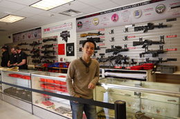 Posing with wall of guns , David Yuen - May 2013