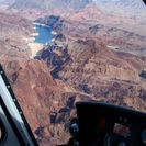 Photo of Las Vegas Ultimate Grand Canyon 4-in-1 Helicopter Tour Helicopter over Hoover Dam.
