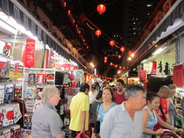 Shopping in Chinatown night market Singapore during trishaw night tour , Anthony R - March 2012