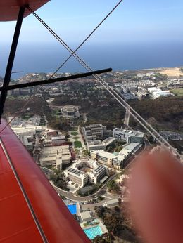 Photo of San Diego Open Cockpit Biplane Sightseeing Ride UCSD campus  and  Geisel Library