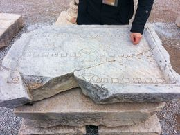 Our tour guide showing us a backgammon board at Ephesus. , Amy C - December 2012