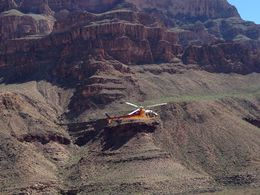 Photo of Las Vegas Best of the West Rim: Grand Canyon Air Tour with Helicopter, Boat Ride and Optional Skywalk Admission Helicopter flying through Canyon