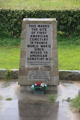 A monument stone commemorating the temporary cemetery for US GI's at Omaha Beach. These soldiers were either moved to the American Cemetery at Normandy or repatriated to the US for burial. , John C - September 2012