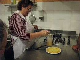 Photo of Florence Tuscan Cooking Class and Dinner in Florence Mom making her crepe