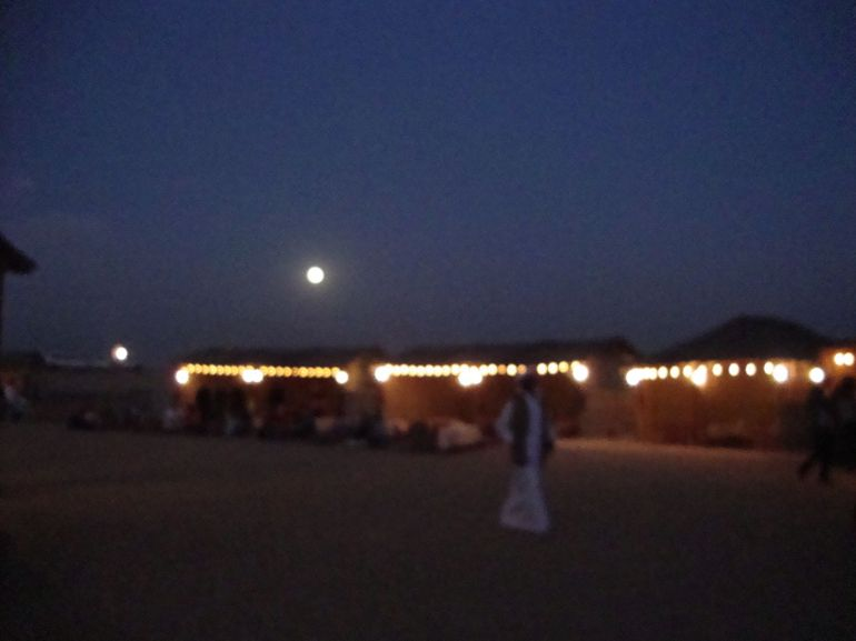 Moon over desert camp - Dubai