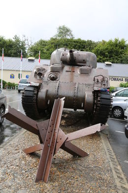 A WWII Sherman tank and one of the hundreds of German obstacles that littered Omaha Beach, making it virtually inaccessable to US landing craft. , John C - September 2012
