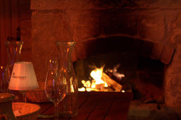 Photo of   Enjoyed Wine by the Fireplace