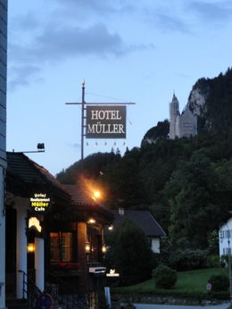 10:30 P.M. it is dusk. The Neuschwanstein Castle is up on the mountain. , Judy & Mike - July 2012