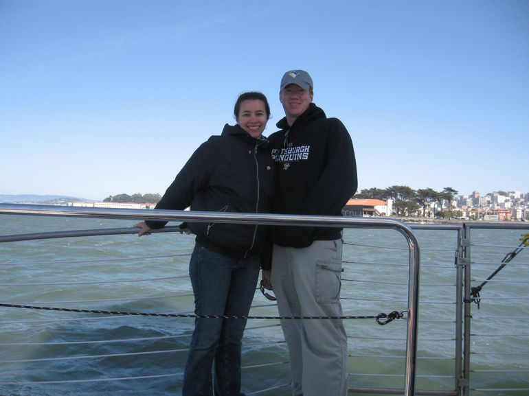 Standing on the side of the cruise boat to get a good picture of us with San Francisco in the background.