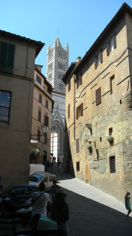 Looking up street in Siena toward spire of cathedral. , Scott F - September 2012