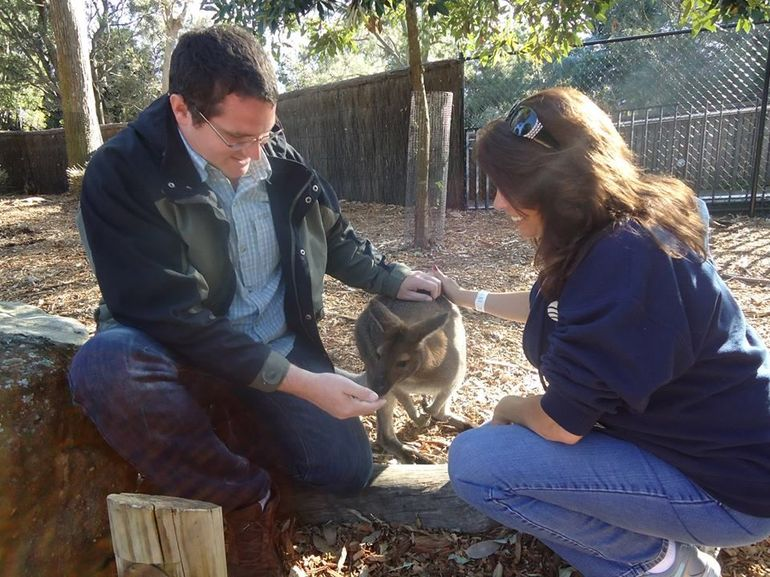Jon and Michelle petting a wallaby - Sydney