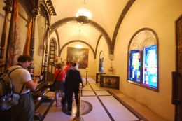 This view allows a small glimpse into the varied paintings, stained glass, architectural detail and marble mosaic tiles that tease your eyes to walk slowly and take it all in before arriving at the ... , Theresanne S - July 2009