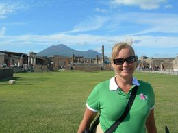 This is me in the foreground, the Pompeii ruins and Mt Vesuvius (volcano that destroyed Pompeii) in the background., Lyn C - October 2008