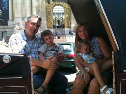 Photo of Paris Romantic Horse and Carriage Ride through Paris Family in Carriage.