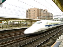 A bullet train shooting past Odawara Station., David F - June 2009
