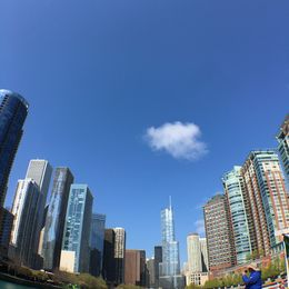 The moment I fell in love with Chicago. Buildings everywhere. In different colors, shapes, and structure. Beautiful day, just that one cloud in the sky. , Jensine D - May 2016