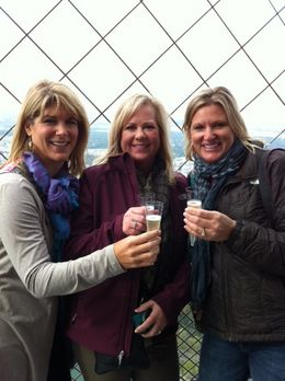 Photo of Paris Skip the Line: Eiffel Tower Tickets and Small-Group Tour champaign toast at Eiffel tower