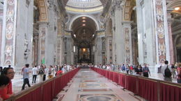 View from entrance to altar. Discs set into the floor mark the size of other famous churches, proving that St Peter's in the largest church in the world. , Geoffrey V - October 2012