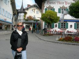 This is me in the little town of Oberamagau, there are many painted houses. This town is also home of the Passion Play that the whole town gets involved in every 10 years., Lyn C - October 2008
