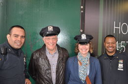 Tim and Sue Nixon with some local NYC policemen. Our tour guide asked them if we could wear their hats! , Sue - April 2014