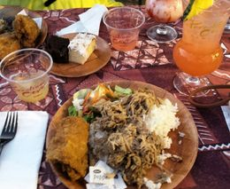 Kalua pigof course fresh from the ground oven, rice, fried chicken, vegies and salad. An assortment of condiments are available also. Dessert is two different cakes. Complimentary Mai Tai and the..., natasha261 - May 2015