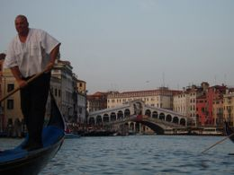A shot of the Rialto Bridge, taken from the Gondola we were in at Sunset., James P - June 2009