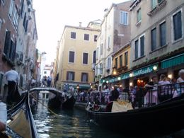 This is one of the smaller canals that our Gondola Ride took us to. The Restaurant already had its lights on, as the light was fading., James P - June 2009